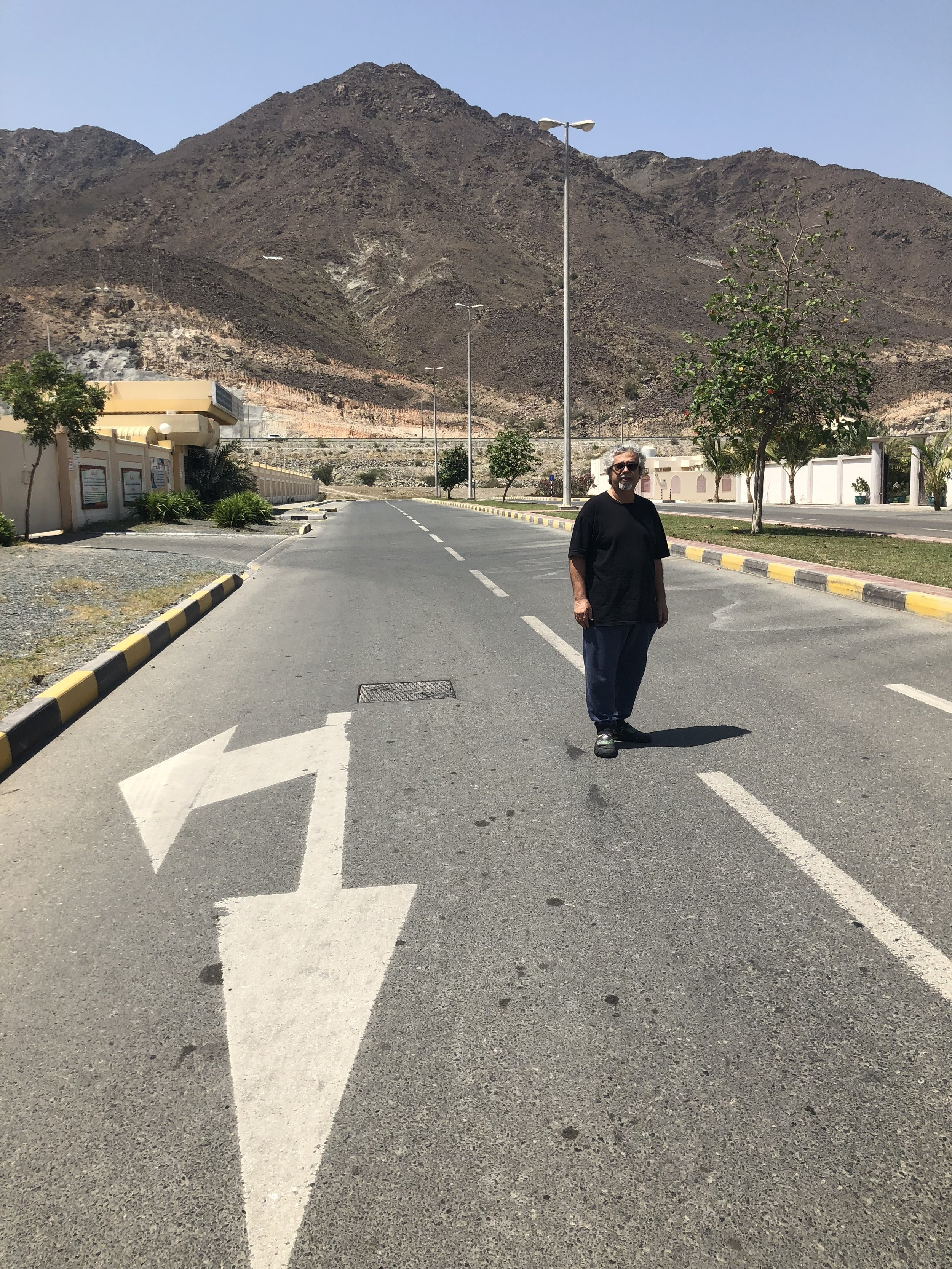 Mohammed Ahmed Ibrahim standing at the foot of the mountain outside his home in Khorfakkan. Image taken by Anna Seaman on March 27, 2018.
