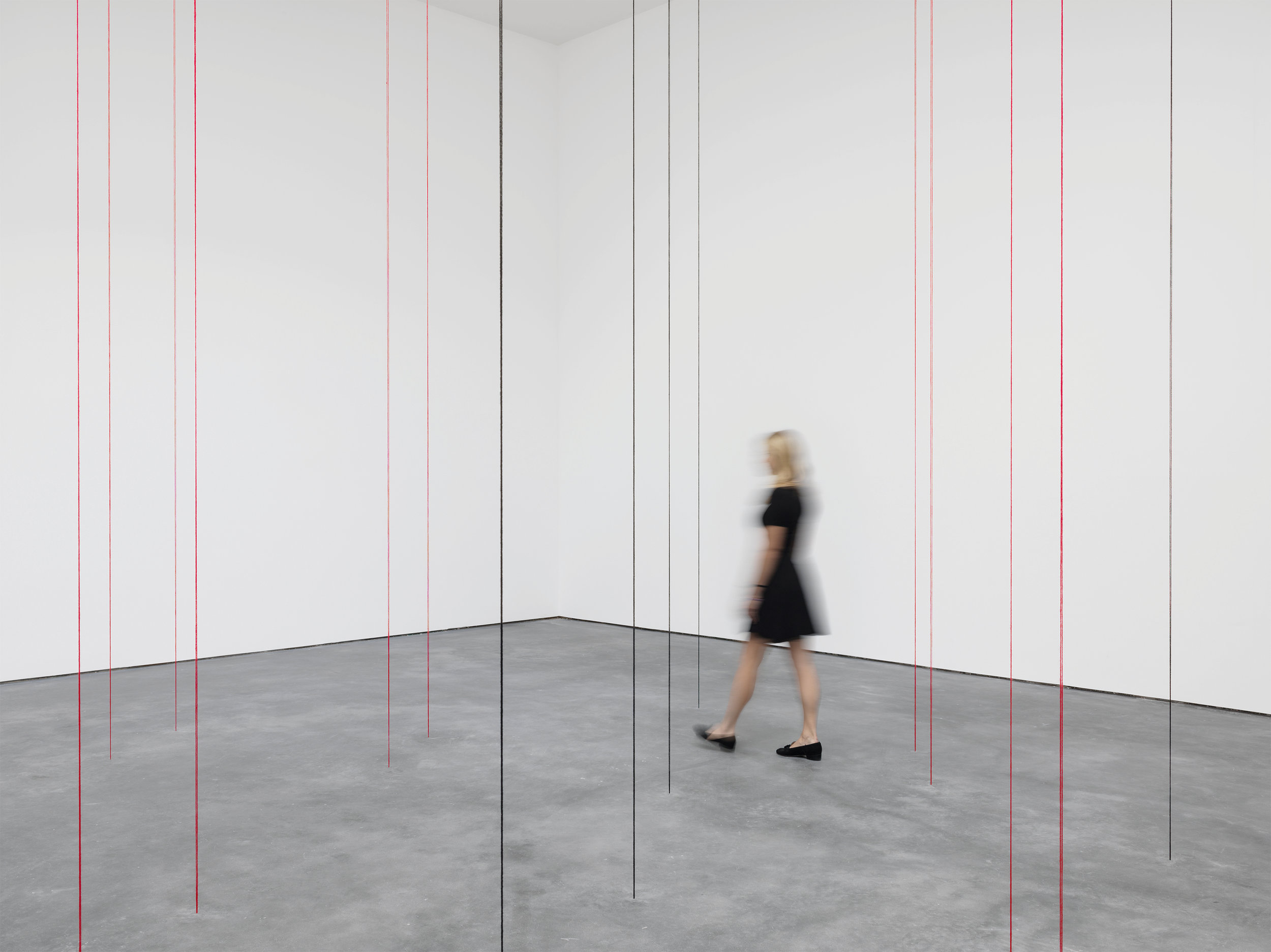Fred Sandback. Untitled (Sculptural Study, Twenty-two-part Vertical Construction) 1991-2016, black and red acrylic yarn, dimensions variable. The Estate of Fred Sandback. Courtesy David Zwirner