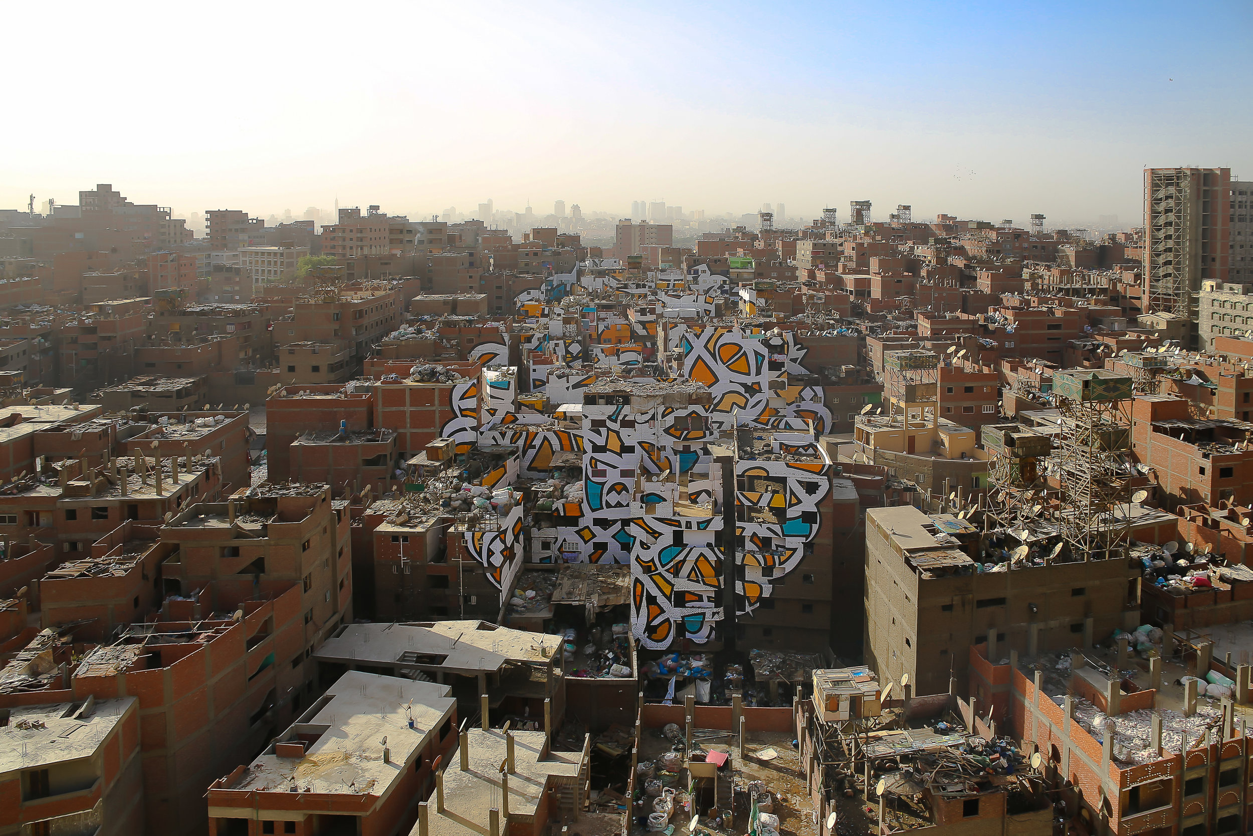 This mural is painted across around 50 buildings in Cairo. Courtesy: eL Seed studio