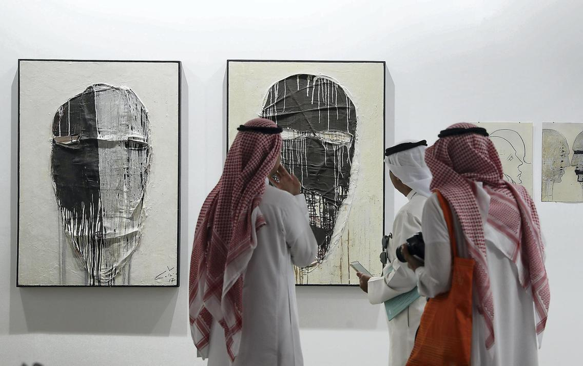Visitors study the works on display during Art Dubai, 2017 at Madinat Jumeirah. Pawan Singh / The National