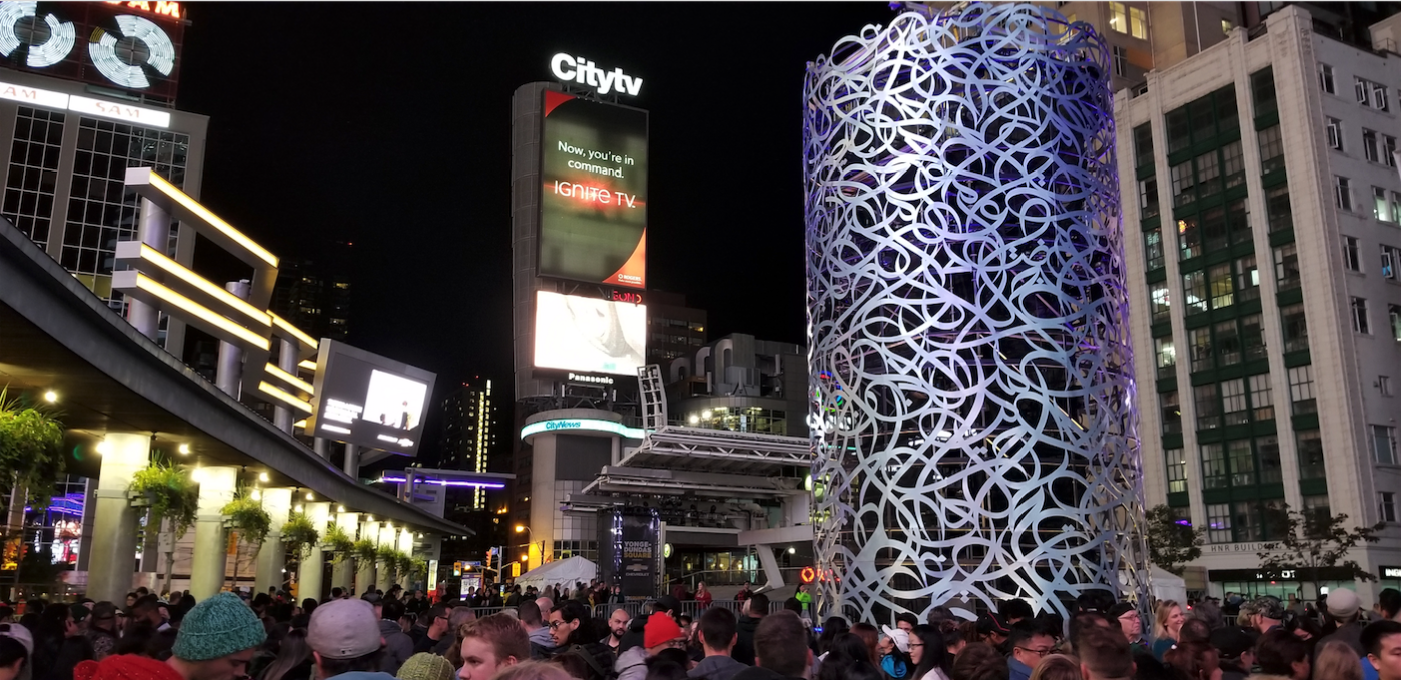 Yonge-Dundas Square in Toronto as part of the annual Nuit Blanche celebrations. eL Seed's towering Mirrors of Babel sculpture represents the plurality of the city. Courtesy eL Seed Studio.