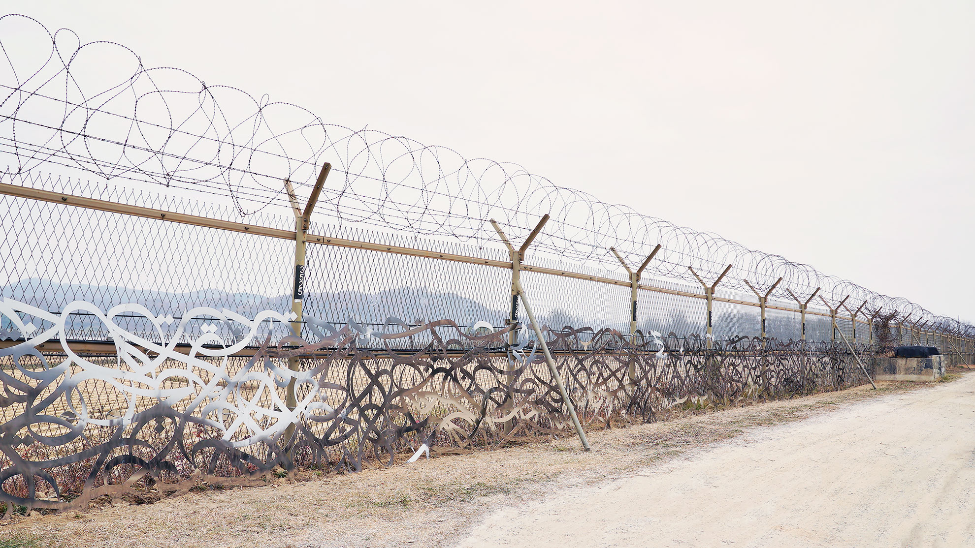 The Bridge, a laser-cut panelled piece installed on the military border between North and South Korea. Courtesy eL Seed.