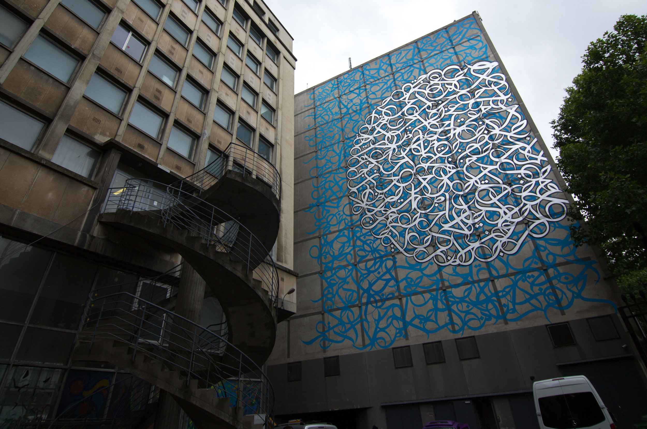 The facade of L'Institut Du Monde Arabe in Paris is painted with eL Seed's calligraphy mural. Courtesy: eL Seed.