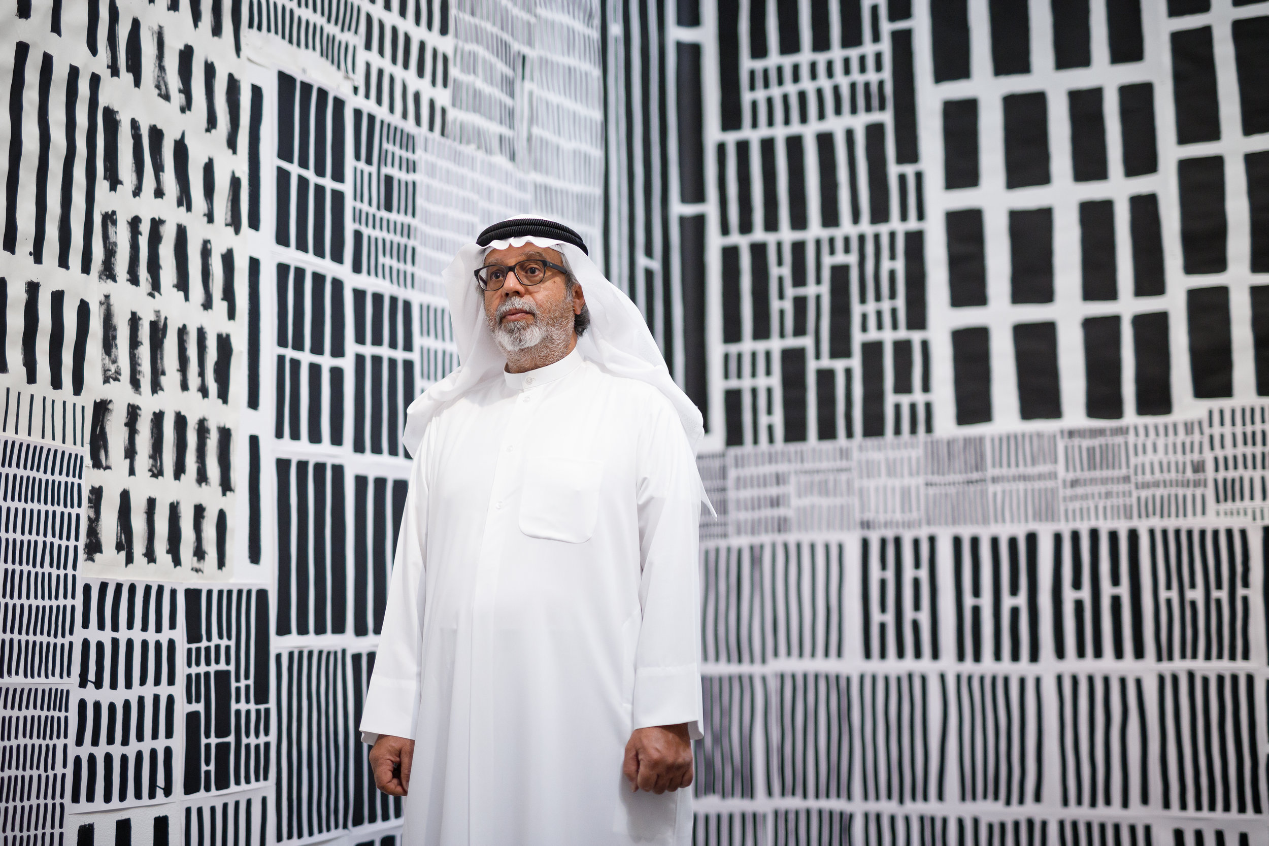 Mohammed Ahmed Ibrahim in his installation room inside his exhibition at Lawrie Shabibi. Image courtesy of Lawrie Shabibi.