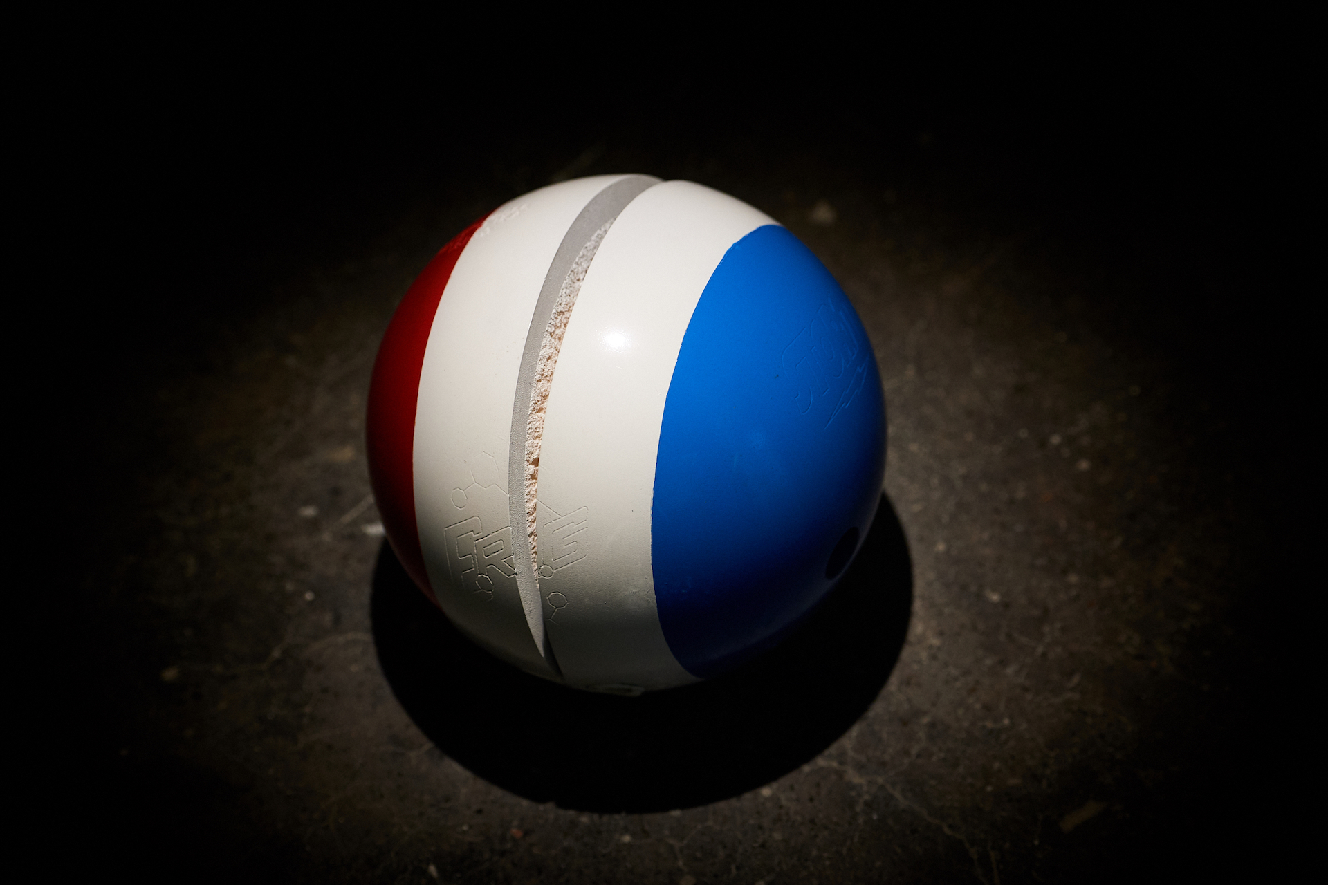 Cristiana de Marchi, Liberté, Égalité, Fraternité, 2018, bowling ball, PU spray paint, 22 cm diameter. Image courtesy of the artist and 1x1 Gallery.