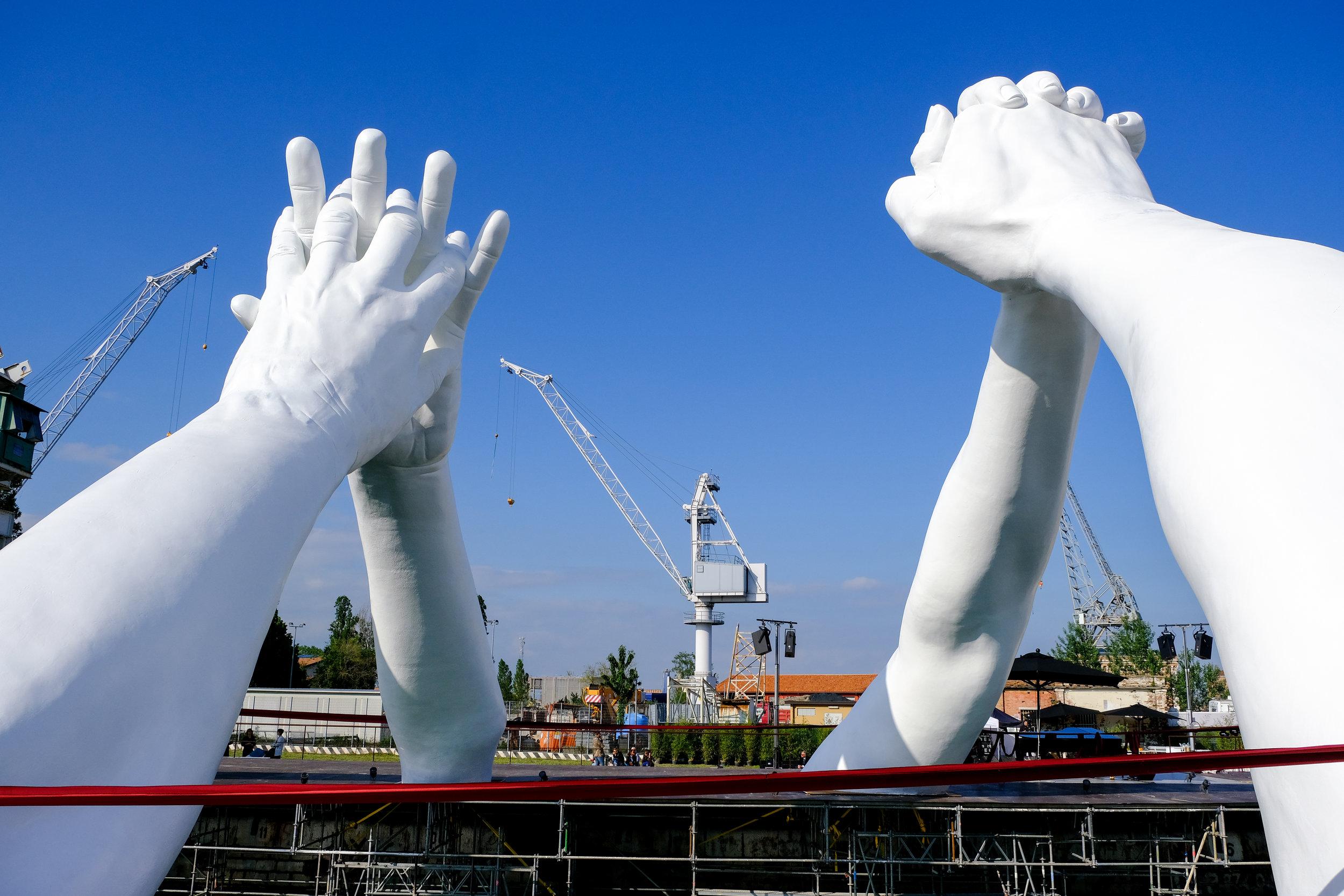 The installation of Lorenzo Quinn's Building Bridges in Venice, 2019. Courtesy Lorenzo Quinn