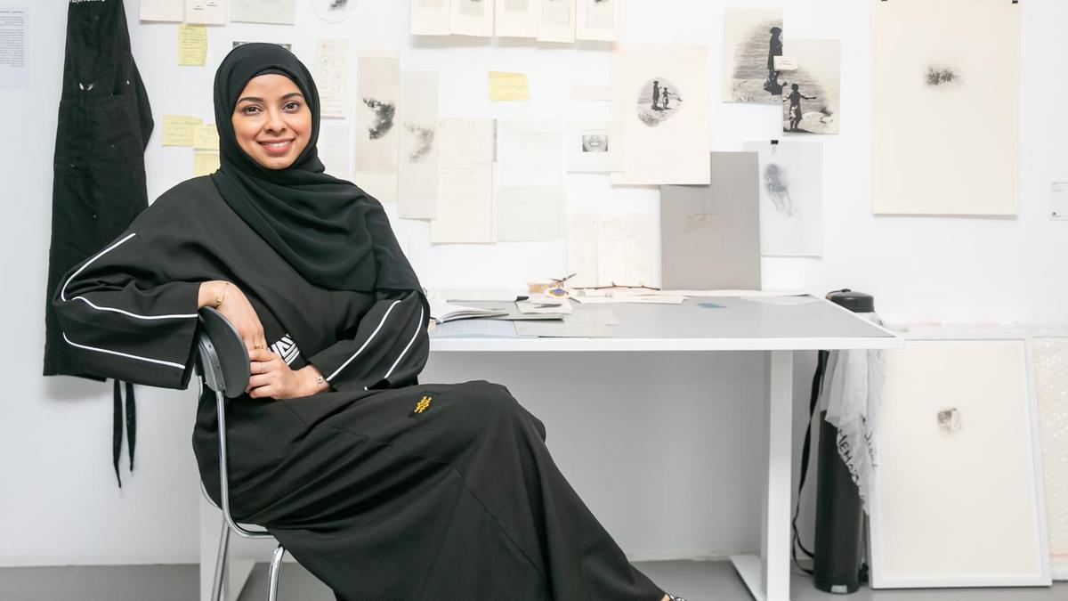Salama Nasib in the replica of her studio for Tashkeel's The Alumni Return. Courtesy Tashkeel.