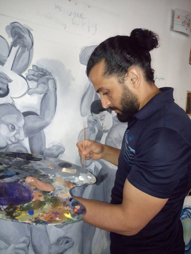 Houssam Ballan in his studio with his paints. Courtesy Houssam Ballan.