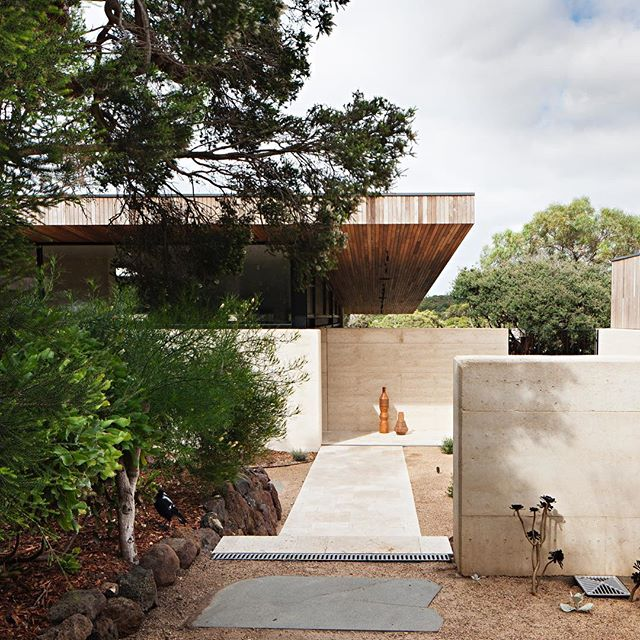 Welcome!! The entry of the Layer House. Built in layers and unfolds the same way  #layerhouse @robsonrakarchitects @earthstructuressurfcoast @sculptform_  #beachhouse #bellarinepeninsula #coastallife #architecture #rammedearth #travertinepavers #timbercladding #surfcoast