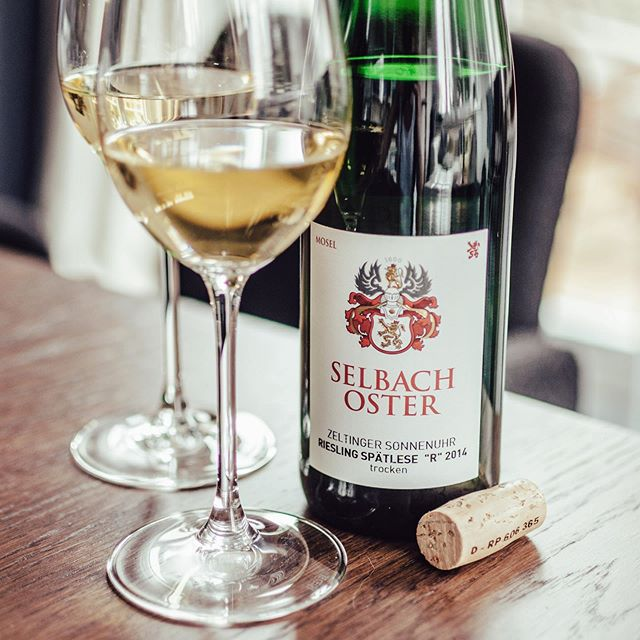 """We enjoy a beautiful #spätlese #trocken tonight from #selbachoster – the #zeltinger #sonnenuhr """"R"""" #riesling #2014 👏👏👏. The collection of @selbachoster is a great one indeed, but the Spätlese """"R"""" is our number one 🚀🚀🚀. An inviting nose of beautiful slate minerality, plenty of great citrus and grapefruit style flavours. On the palate you get the full juicy, dense and long potential of the great wine. Fruit notes of apple, stone fruits, powerful acidity, great stony minerality in the great and super harmonic, soft finish. You got to love this 😊🌟🥂... @hannahselbach #wine #winelover #winefreak #sommlife #sommelier #finewine #somm #wineo #wein #vino #winetime #winenot #wineenthusiast #wineporn #instawine #winestagram #winetasting #ilovewine #winemaker @foodandwine @winecellartv @wineenthusiast @winewankers @winefortheheart @winespectrum @wine_spectator @wine @winetouristmag @winerist @onceuponawine_ @wineesquire @wineexpo @winebrandao @winesocialclub @wine_everyday @simply.wines @wineconsumer @thewinebro @ @tastingvintages @winerylovers"""