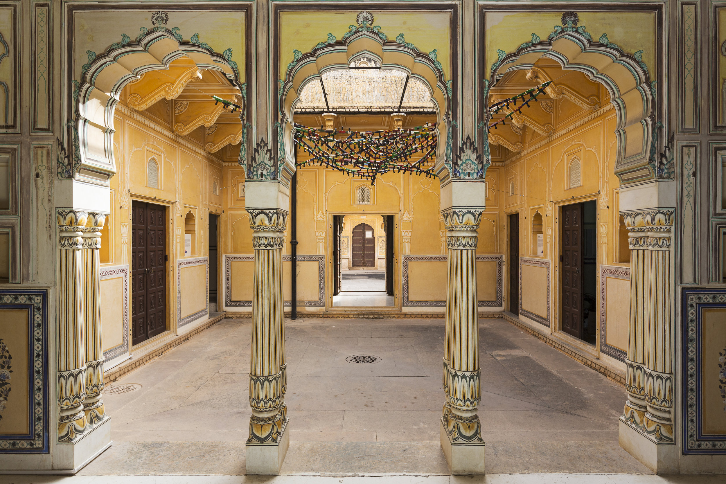 Back in the 1800s the palace was home to Maharaja Sawai Jai Singh and his wives. In this courtyard we see Reena Saini Kallat's work 'Untitled (cobweb)' overhead.