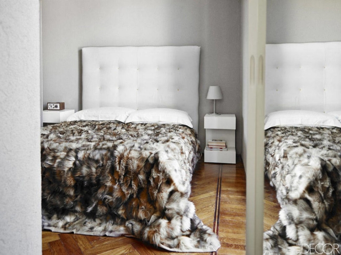 Alessandro-DellAcqua-Milan-home-bedroom-light-gray-walls-Artemide-white-tufted-headboard-wood-herringbone-floors-fur-blanket1.jpg