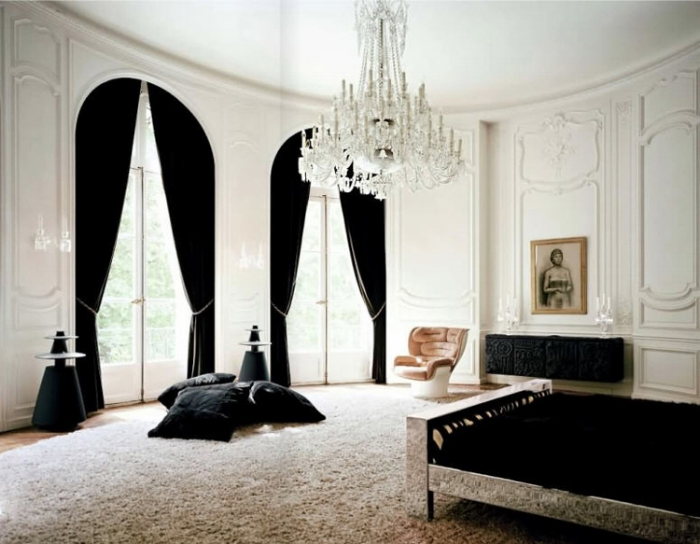 Lenny-Kravitz-Paris-apt-bedroom-black-white-fur-glam-chandelier-1970s-chair1.jpg