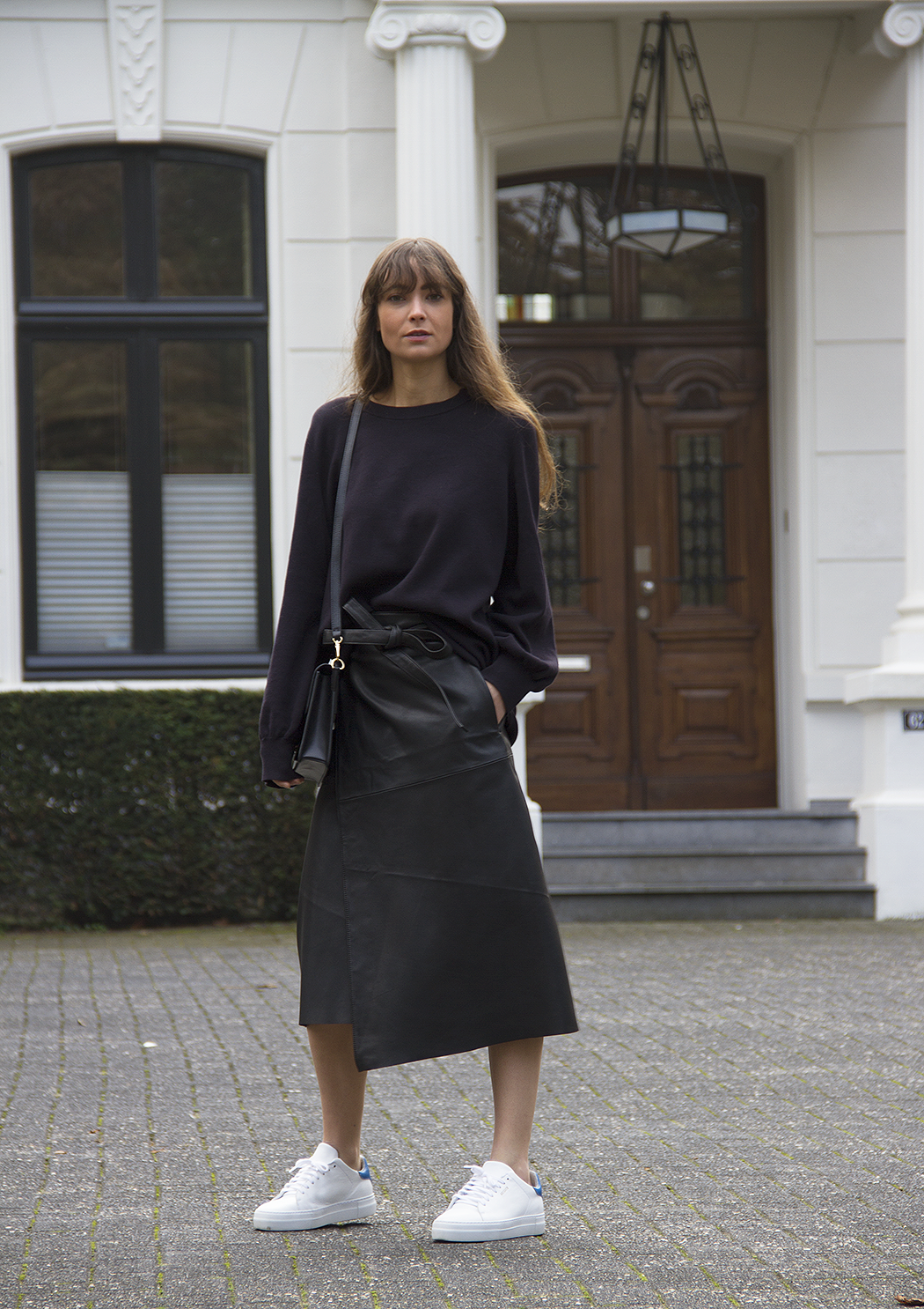 Cos sweater, Maje leather wrap skirt, Axel Arigato sneakers, Ralph Lauren bag.png