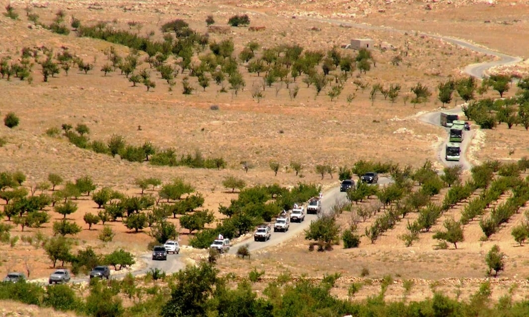 Vehicles make their way through Lebanon as part of the repatriation of Syrian refugees in August 2017. Photograph: Anadolu Agency/Getty Images/The Guardian