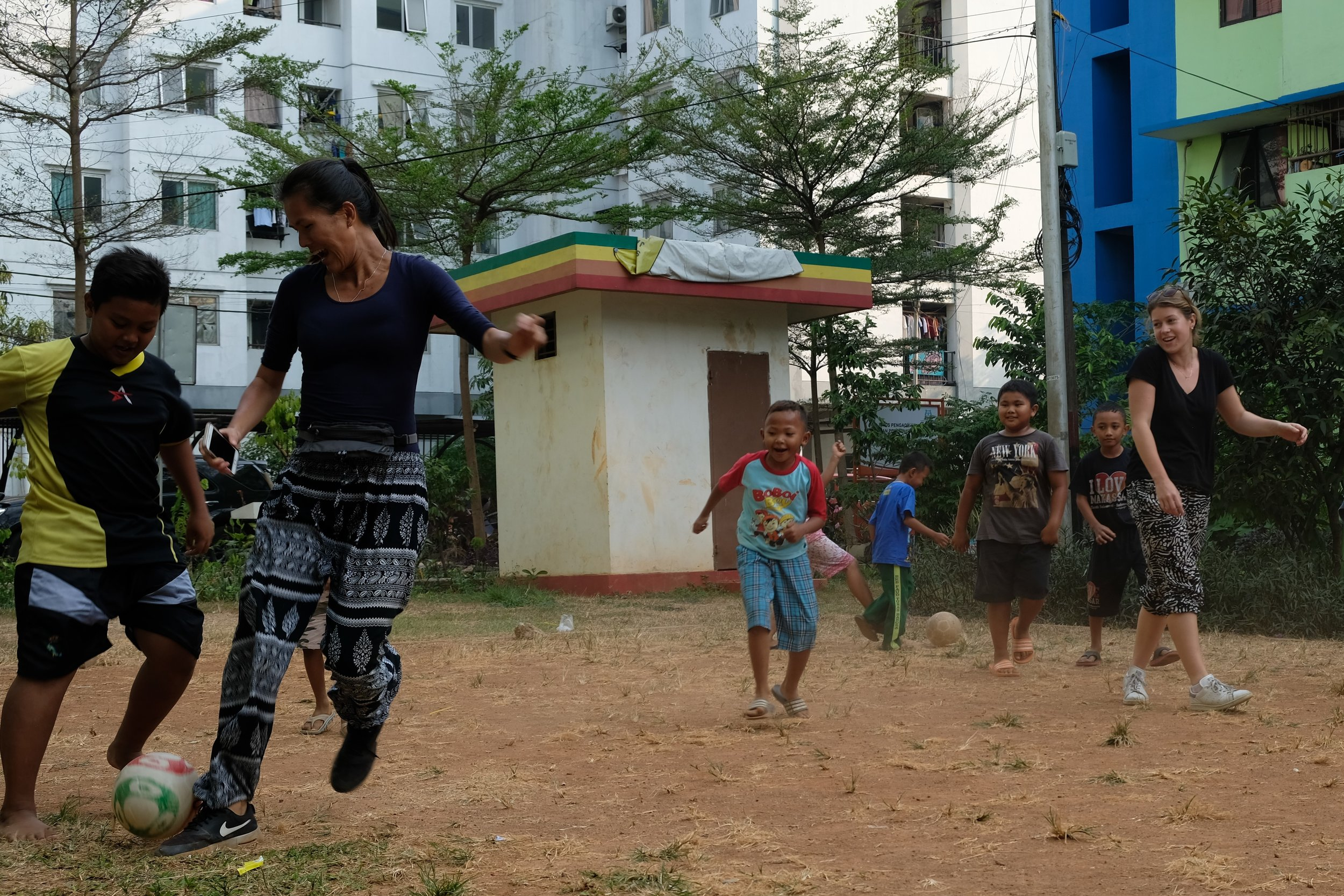 Kids know how to brighten any situation, and how to turn any area into a soccer field.