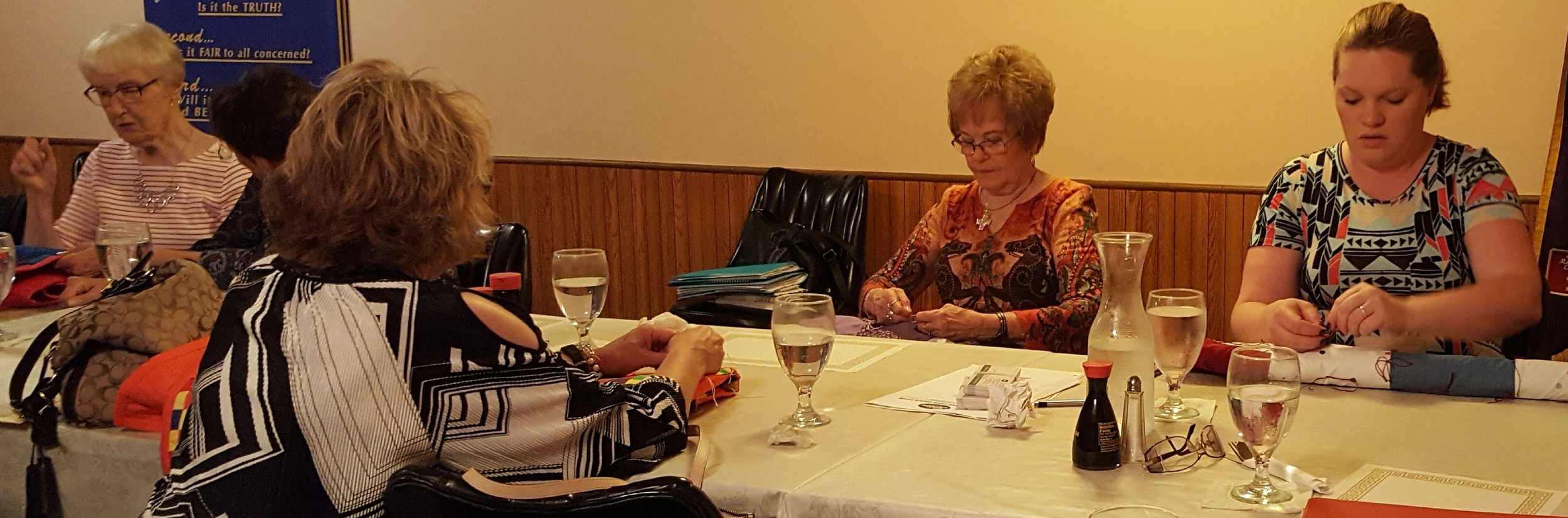 Great Bend Bend Pilots tie quilts at one of the meetings.
