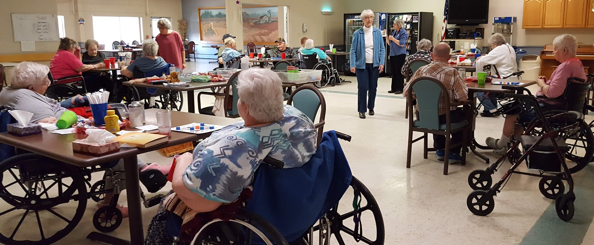 On March 19, 2019 Great Bend Pilots Sally O'Connor & Norma Ward assist residents at Great Bend Health & Rehabilitation with Brain-O Bingo. Janice Walker calls out the picture on the call-card and gives the appropriate safety tip that matches the picture.