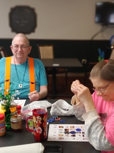 Medicalodge residents play BrainO Bingo.