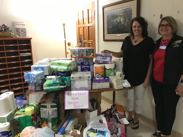 Supplies, cash and Visa cards collected by Pilots and donated to Arrowhead West. Pictured are Shelia from Arrowhead West and Faye Kuhn, govenor of Heartland District Pilot Club.