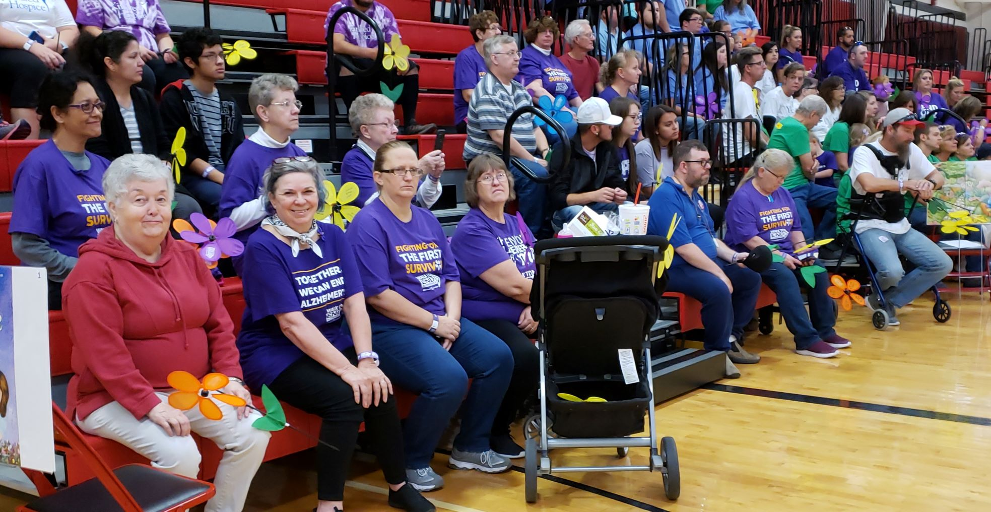 Participants unite for a heartfelt opeining ceremony prior to the commencement of the Alzheimer's walk. Note the Pilot members among the group.