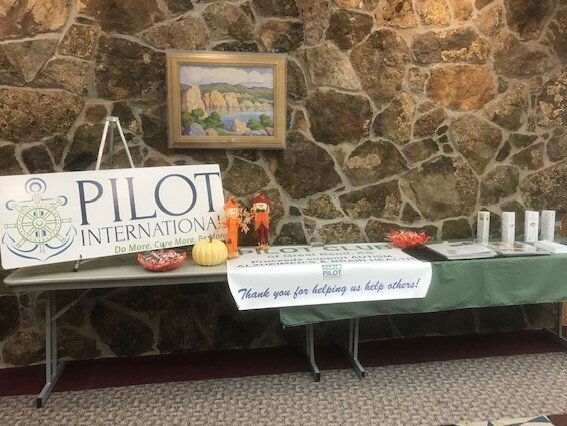 The items on display are the club's banners, information about pilot club and their story, and a scrapbook of activities and projects. Pilot Club hopes to encourage others to join their club.