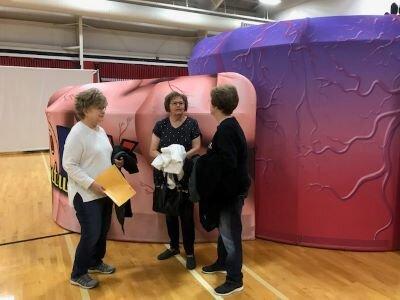 Joyce Beadles-Fry, Sharon Mauler and Nancy Schuetz visit prior to doing the Body Venture presentations.