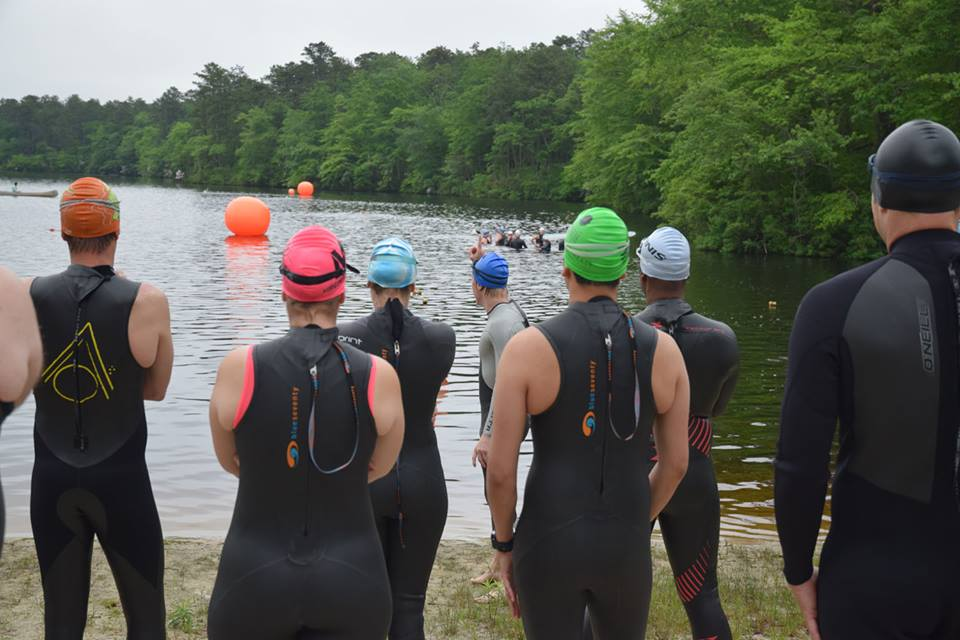 ETA Coach - ETA Coach, founded by the late Jason Kilderry, holds regular open water swims at YMCA Camp Ockanickon in Medford Lakes, NJ. The 2018 schedule is as follows:Thursdays 4PM – 7:30PM May 3, 10, 17, 24, 31 | June 7, 14, 21, 28 | July 12, 19 | August 2, 16, 23, 30 | September 7, 14Saturdays 6:30AM – 11:00AM April 28 | May 5, 12, 19, 26 | June 2, 9, 16, 23, 30 | July 7, 14, 21, 28 | Aug 4, 11, 18, 25 | Sept 1, 8, 15, 22Sundays 6:30AM – 11:00AM April 29 | May 6, 13, 20, 27 | June 3, 17, 24 | July 1, 8, 15, 22, 29 | August 5, 12, 19, 26Wednesday 5-7:30pm (Informal Open Water Swim Races) May 16, 23, 30 | June 6, 13, 27 | July 11Visit ETA Coach's website for all Open Water Swim and Open Water Swim Clinic Information: http://www.etacoach.com/open-water-swims-and-swim-clinics/1 Day passes can only be purchased at the lake for $15.00 Cash or Check per Lake Swim. (This does not include lifeguard gratuity).Once you have registered, please bring your ticket receipt to the lake, along with a photo ID and your USAT Card. If you don't have your pass, photo ID, or USAT Card, you can't swim. Non-USAT members can purchase a 1 day USAT pass for $12.00.ETA also runs periodic open water swim clinics, designed to help beginner to advanced swimmers become more comfortable in the open water. They do this by practicing skills which will help each swimmer offset anxiety and navigate swim courses more effectively, resulting in safer and faster open water swimming.YMCA Camp Ockanickon is a nice swim venue. Don't be fooled by the dark brown water color due to the local Jersey pines. The water is clean tasting and water quality is good.