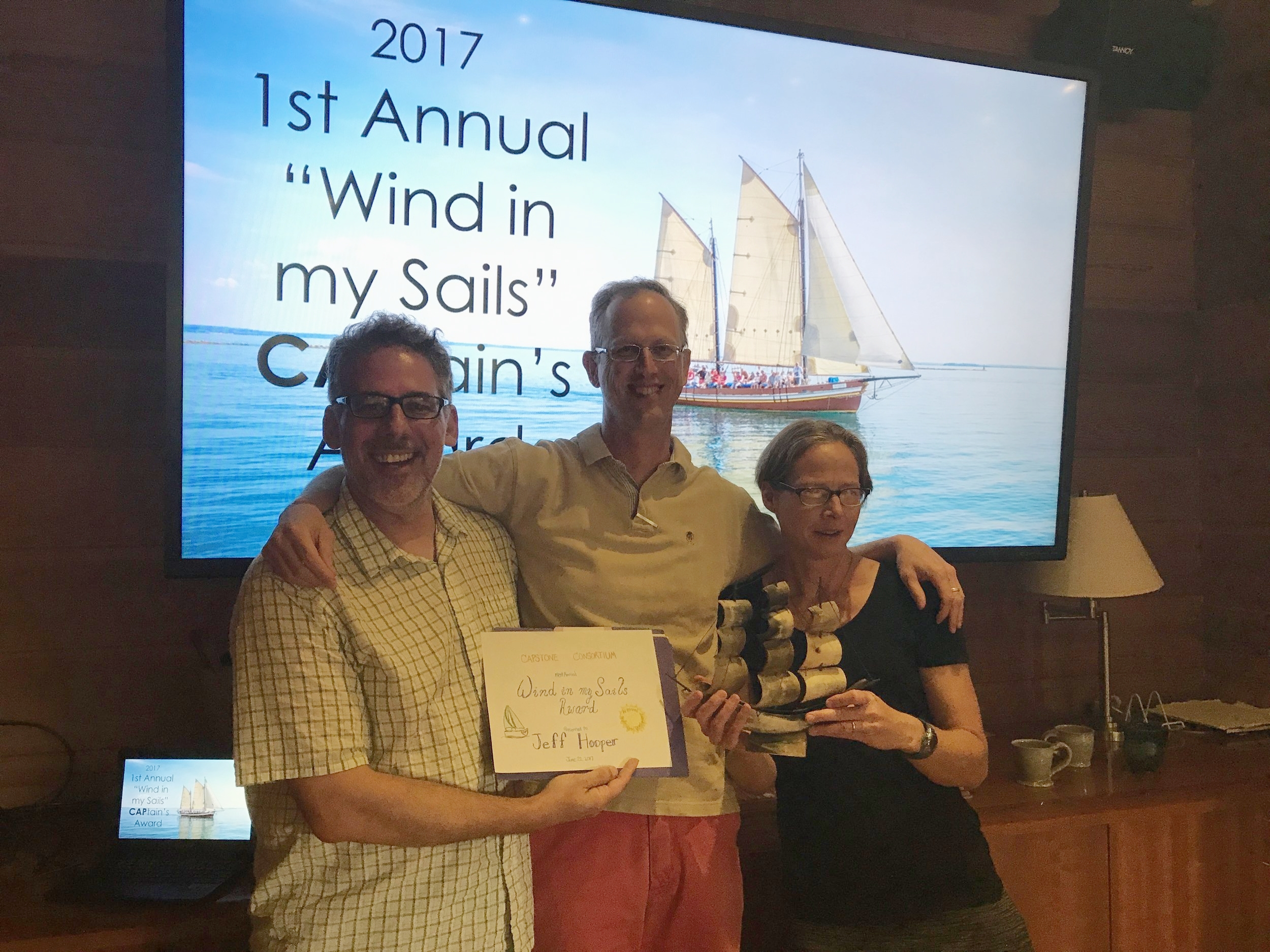 "Jeff Hooper (center), 2017 winner of the ""Wind in my Sails"" CAPtain's Award, along with Steve Chinosi (left) and Nina Leacock (right)"