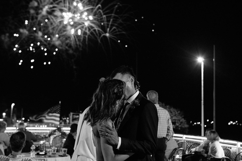 bride-and-groom-kiss-under-fireworks.jpg