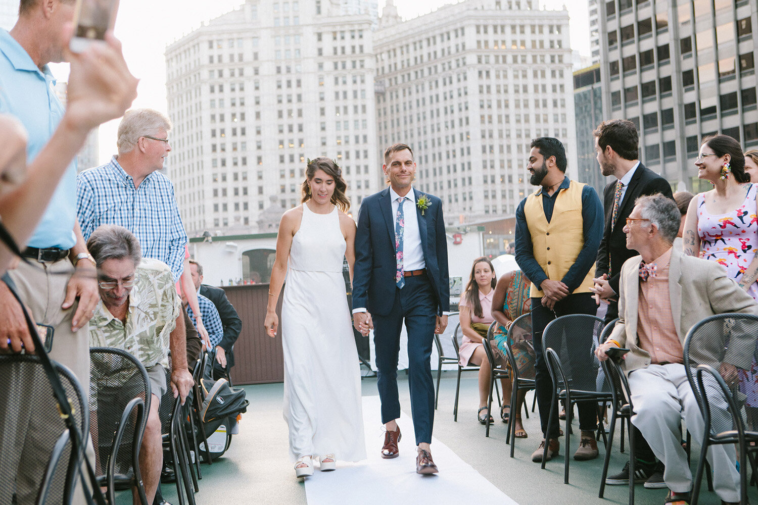 bride-and-groom-walking-down-aisle-downtown-chicago.jpg