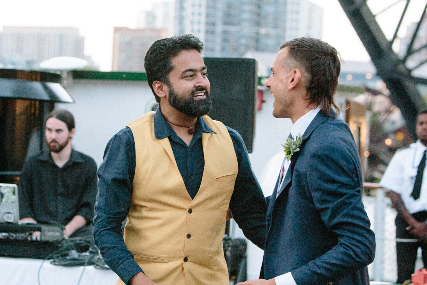 groom-and-friend-chatting-chicagos-leading-lady.jpg