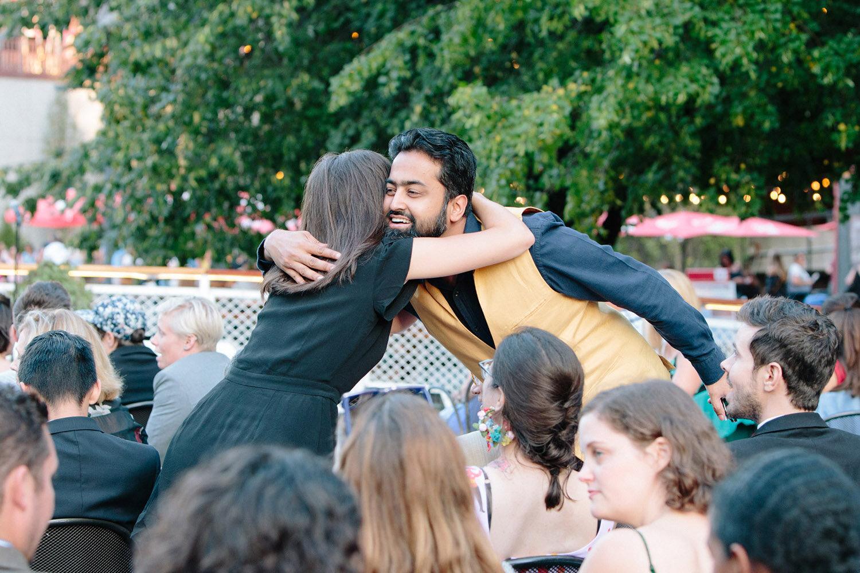 wedding-guests-hugging-on-chicago-boat.jpg