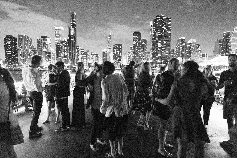 wedding-guests-dance-on-boat-chicago-skyline.jpg