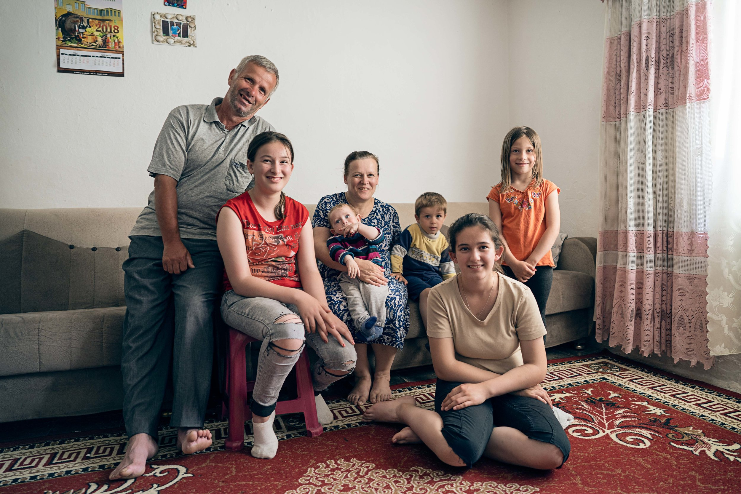 A family saying thank you to a christian organisations that made a much needed hip operation possible, Kukës County.