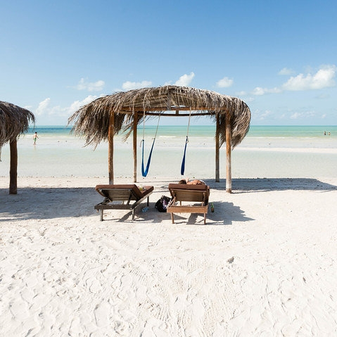 Palapas Del Sol, Isla Holbox - A charming and lovingly maintained property on the beautiful and remote Isla Holbox. Sandy streets and uncrowded beaches surround this perfect retreat. The ocean is calm and inviting, perfect for little ones to take their first dip. See our Ready & Roam Holbox post for all the destination details.