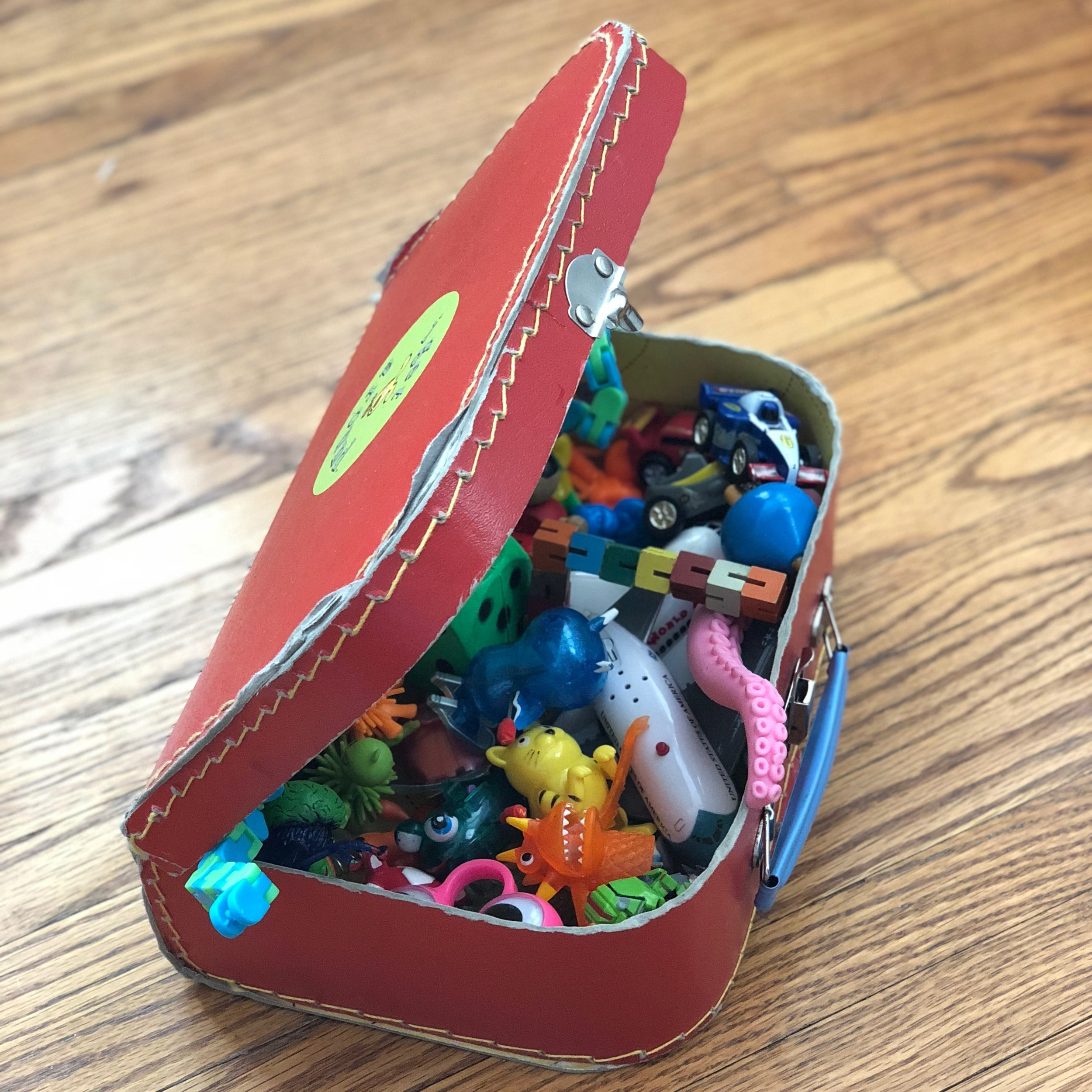 Junk - Enter Oriental Trading. We keep a luggage case filled with an assortment of jumping plastic, wind-up toys, vending machine finger puppets, Chinese handcuffs... you get the idea. We call this box the