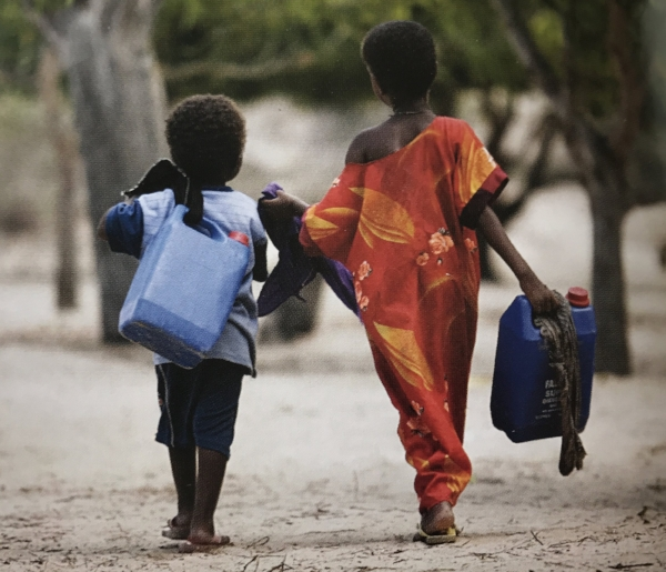 Two children walk from the well in Hope Village. Photo: Sabal Abdulle.