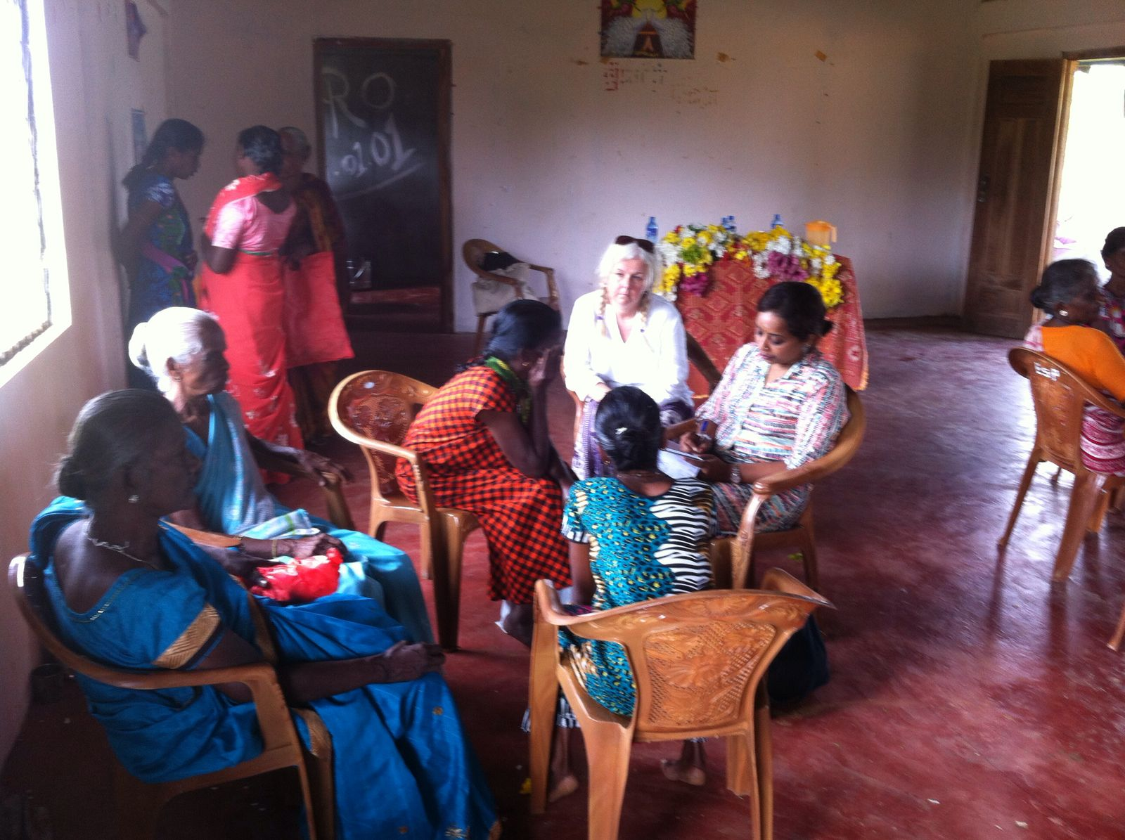 Elizabeth talking with elders to find out what they need.