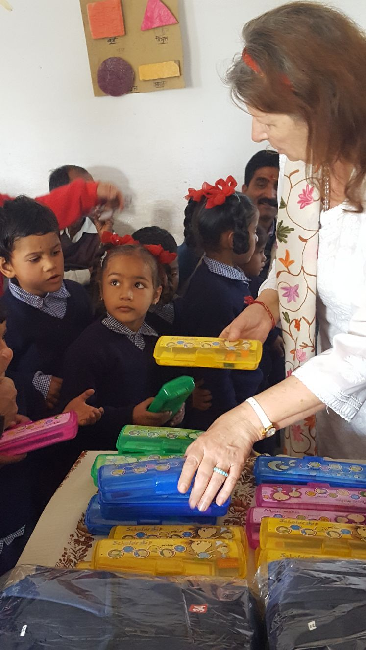 Padma giving out school supplies.