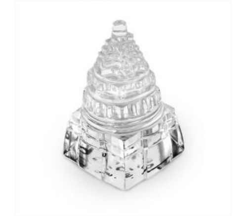 Photo of a 3 dimensional Sri Yantra made in crystal, which you can often see on our altar.