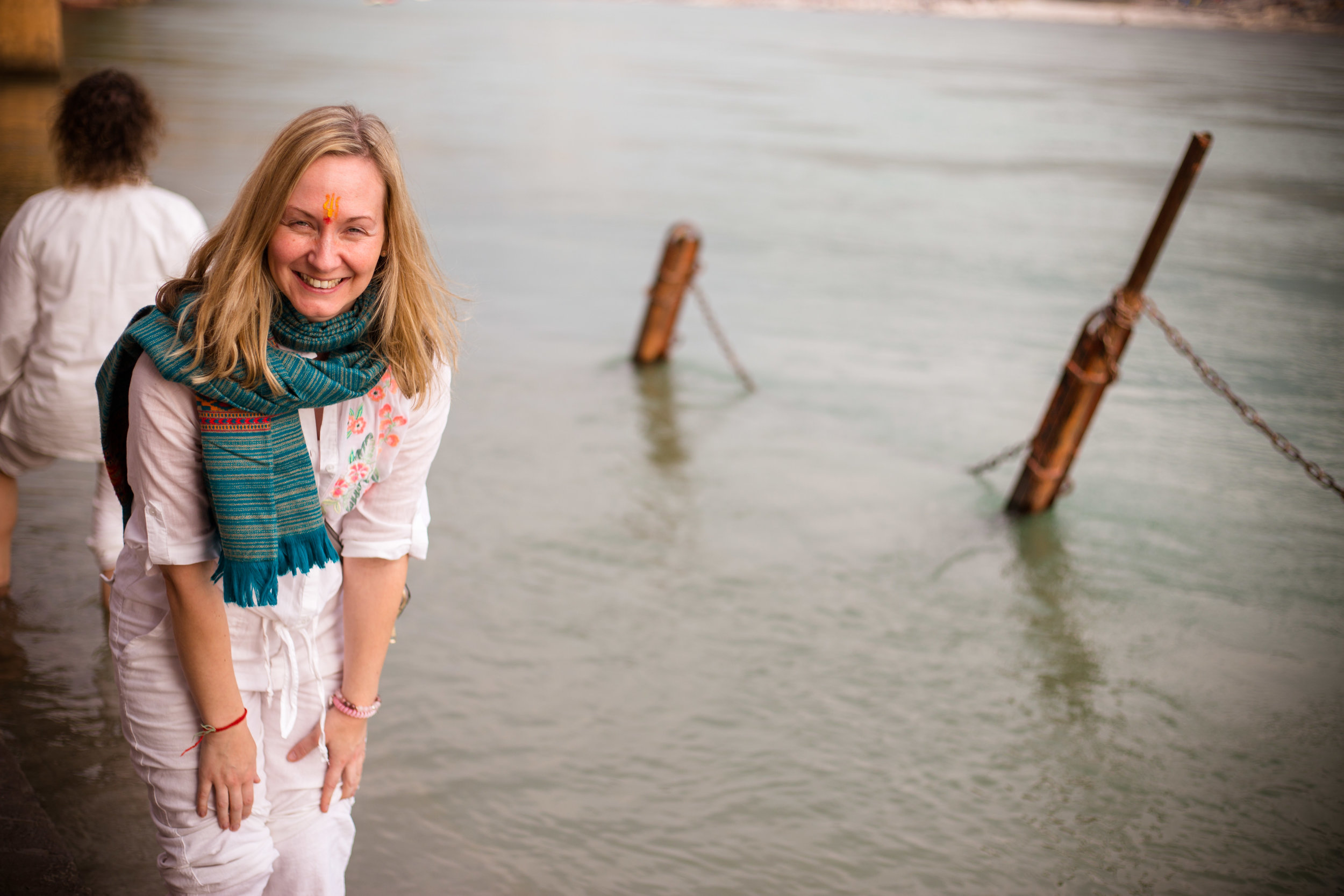 Bodhini enjoying the blessing of Divine Ganga Ma (River Ganges) on the Heart Of Living Yoga Teacher Training in Rishikesh, January 2019. Photo credit: Akasha Alix @ Lumiere photography
