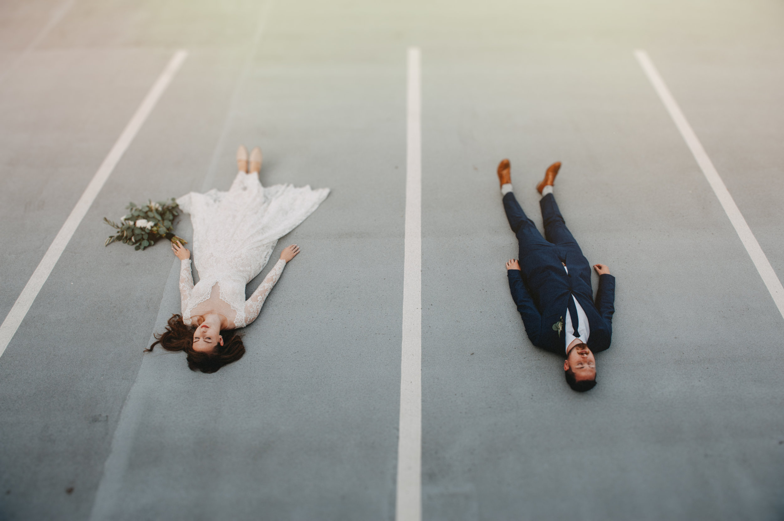 Vancouver Wedding Photographer - Artistic Bride And Groom Lying On The Ground