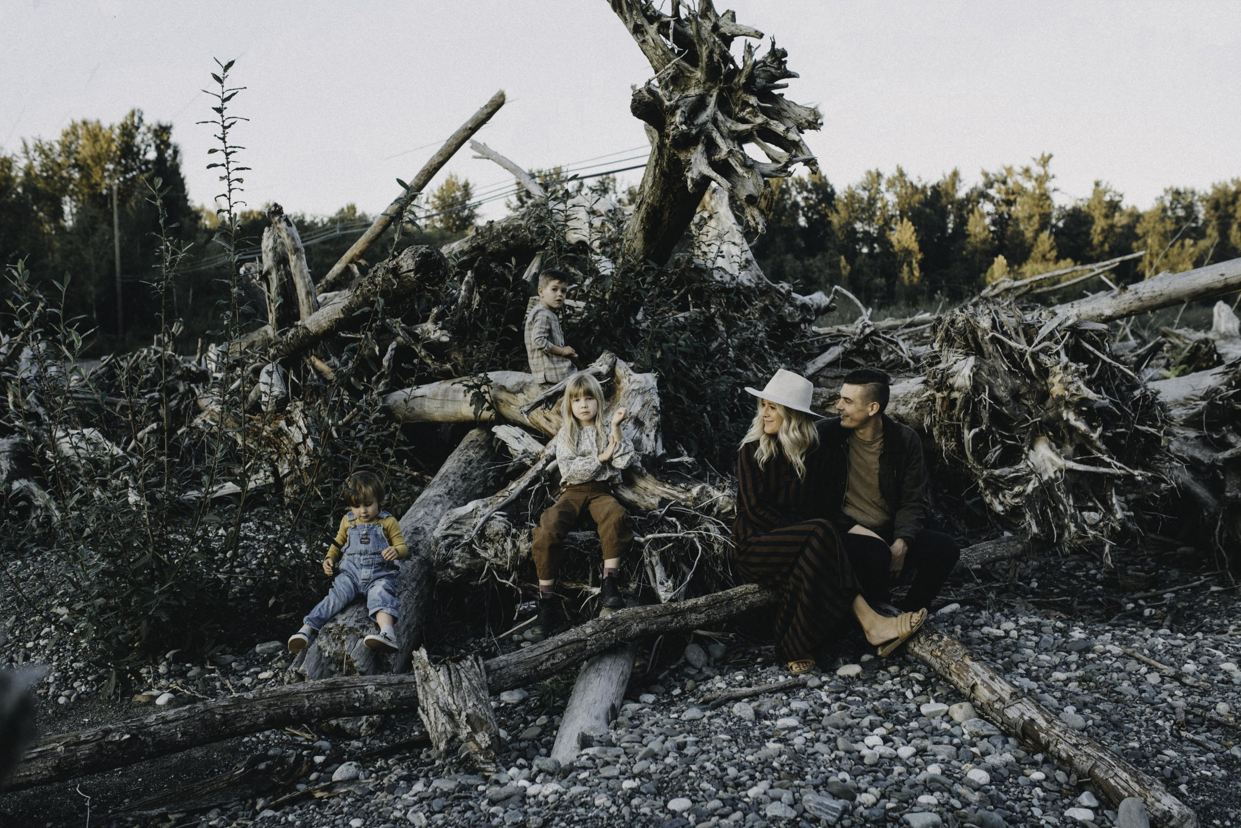 Vancouver Family Photographer - Family Sitting On Logs