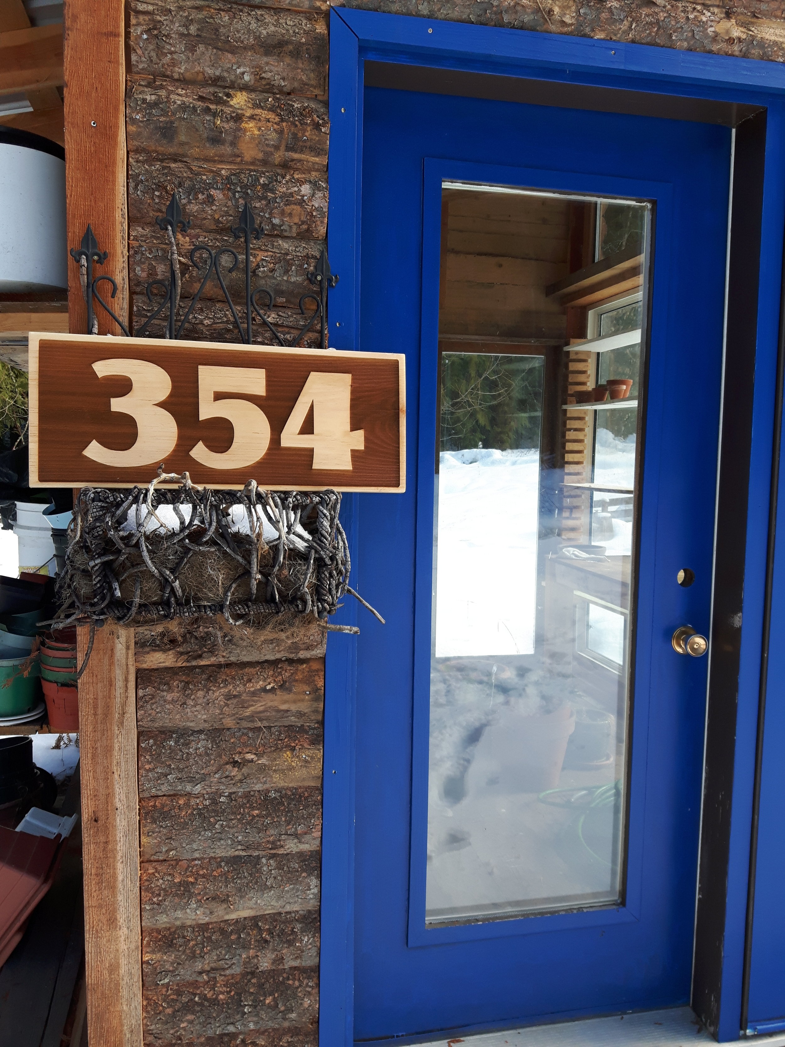 """House number, reverse engraved on pine.  Approx 10"""" x 2'. $135"""