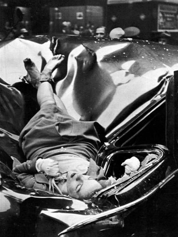 The body of 23-year-old Evelyn McHale rests atop a crumpled limousine minutes after she jumped to her death from the Empire State Building, May 1, 1947. Robert Wiles.