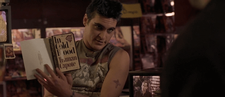 Joaquin Phoenix reading Truman Capote's  In Cold Blood  (1966) in sex shop; from Joel Schumacker's  8mm  (1999).