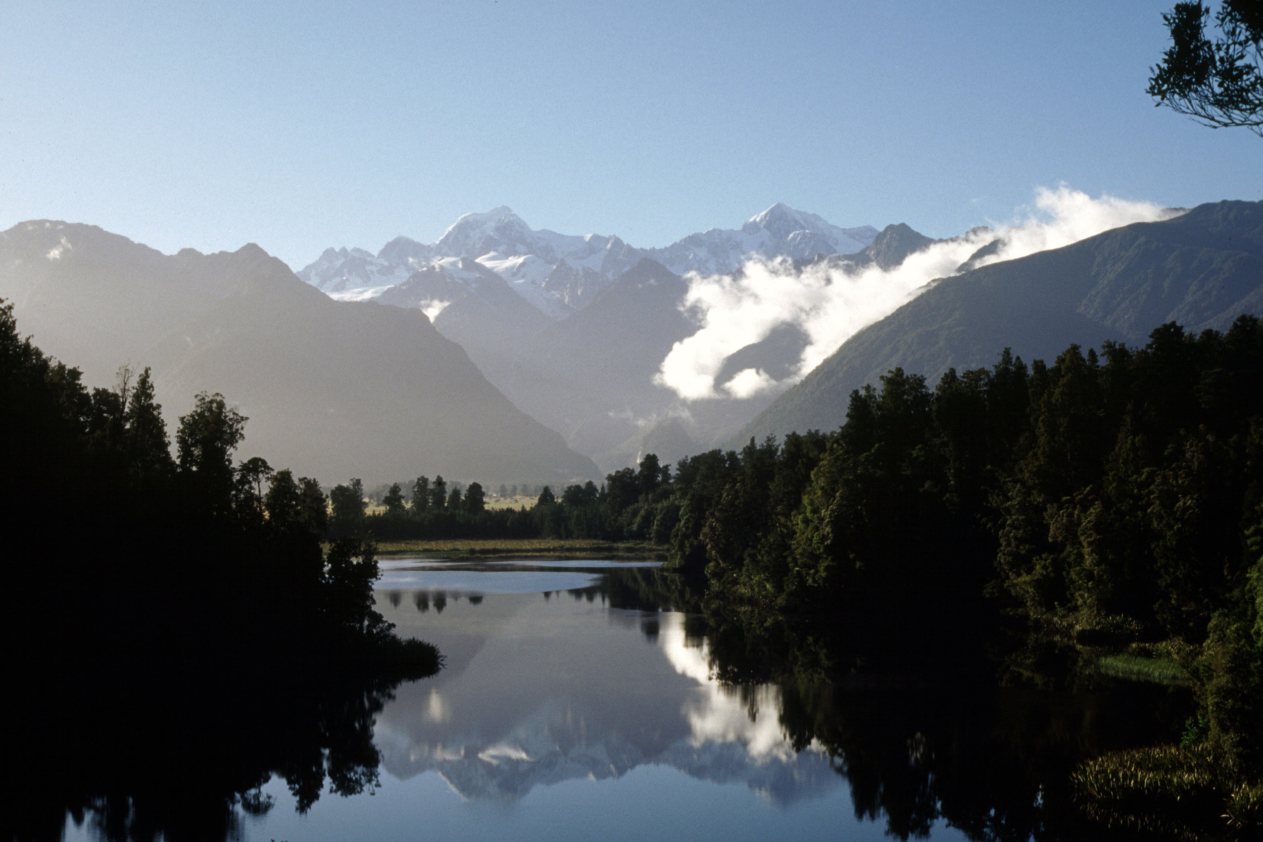 Lake Matheson, near Fox Glacier, Mount Cook and Mount Tasman reflected.