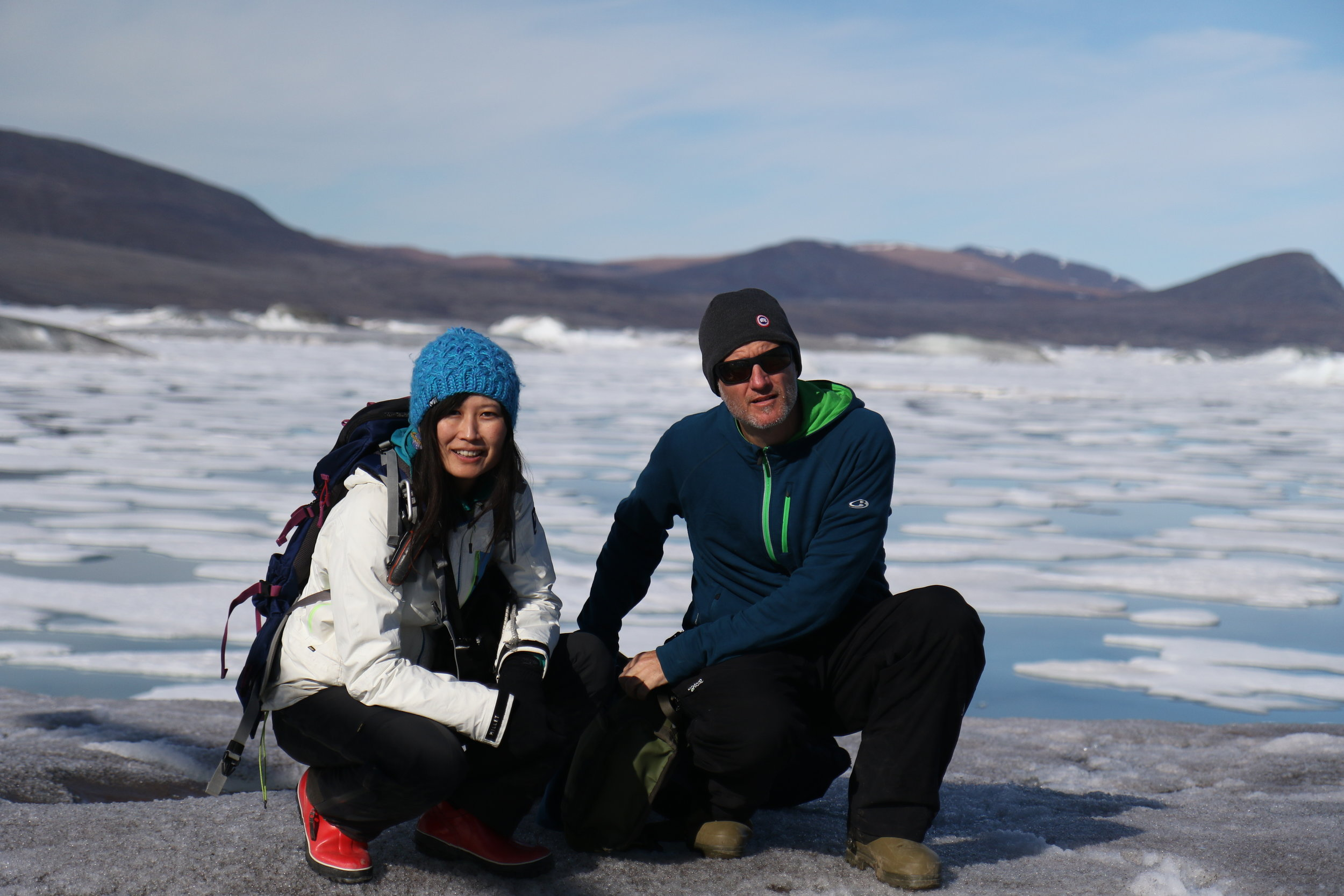 Yukiko Tanabe & Alex Culley sampling from an ice island in  Disraeli Fjord  (photo by D. Sarrazin)
