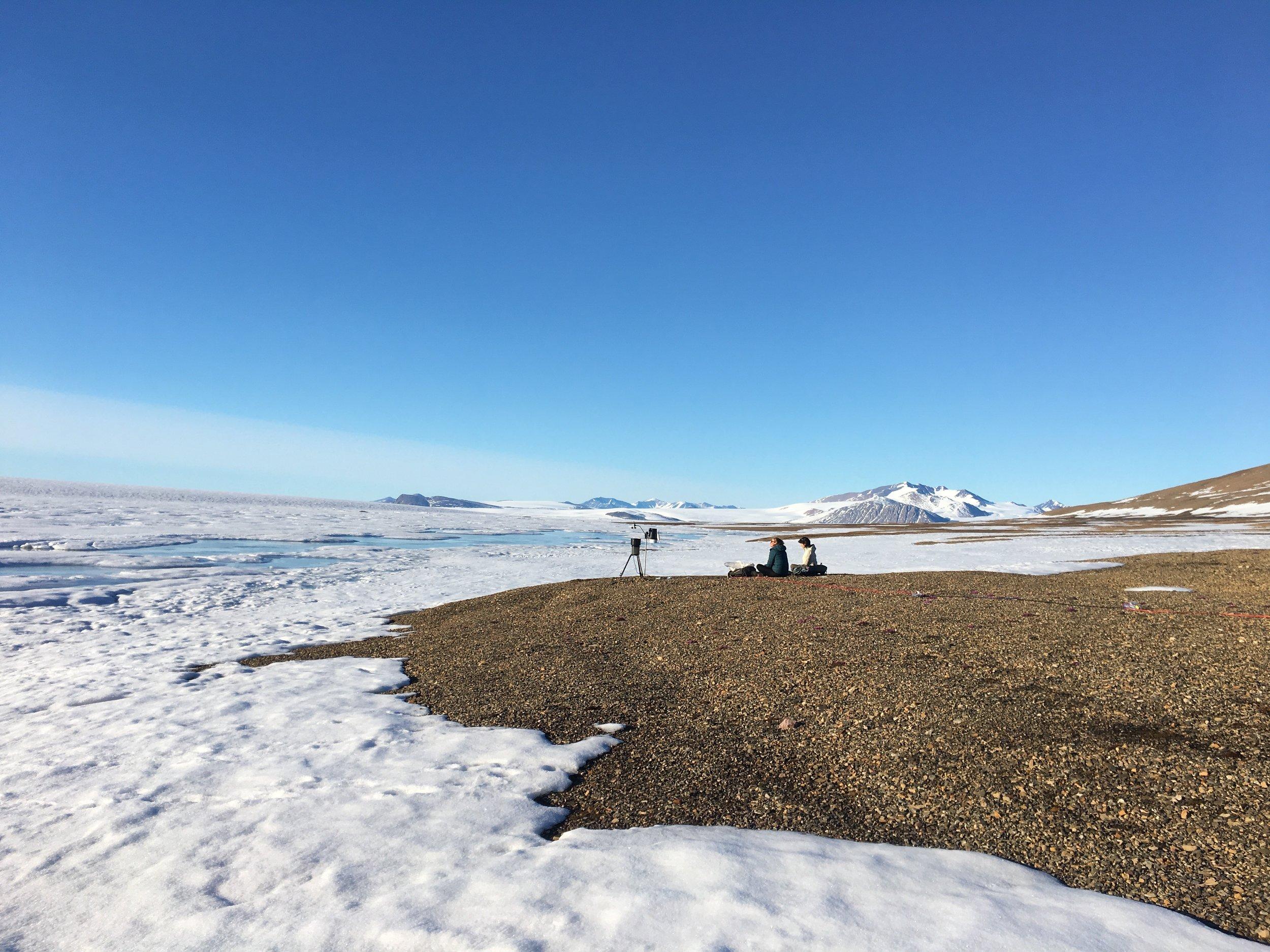 Catherine Girard and Elise Imbeau collecting aerosols near the lagoon on Ward Hunt Island